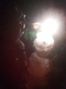 snowman building at night in suncadia with kids