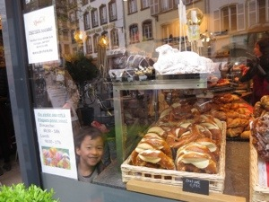 buying bretzels in strasbourg with kids is a great treat