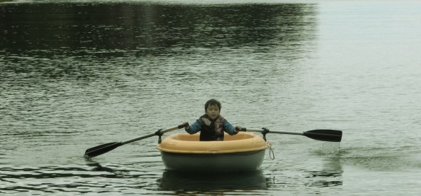 my little boy paddling his own boat