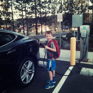 family travel in a Tesla