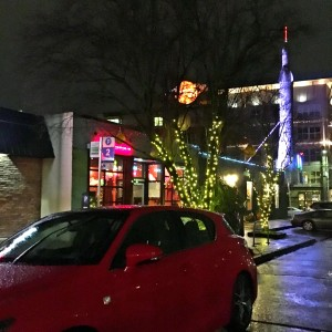 red lexus ct in fremont seattle with sparkly rainy light