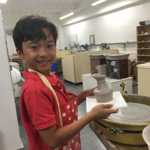 Kids making pottery in the Mastercraft Studio in the World of Wedgwood