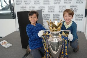 Holding the Premier League Trophy at the National Football Museum in England