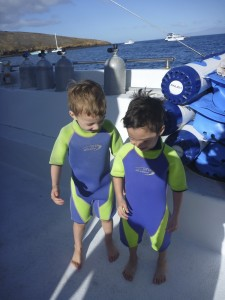 Snorkeling with kids on Maui wearing wetsuits