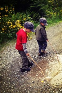 hiking with kids they always need sticks and puddles