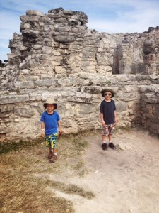 looking for iguanas at Tulum ruins in Mexico with kids