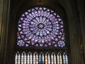 Admiring the Stained glass in Notre Dame