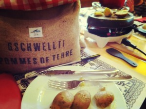 eating fondue and raclette in switzerland with kids