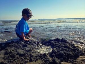 water washing sand castle away