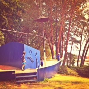 big blue boat in park on bainbridge