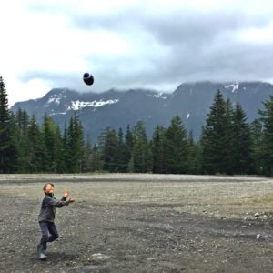 Playing football in our rainboots near Snoqualmie pass