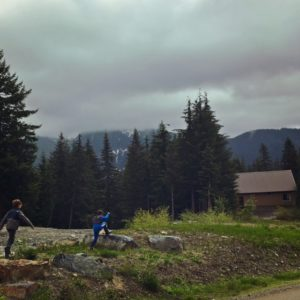 Running in the mountains in our rainboots-gear for kids hikes near seattle