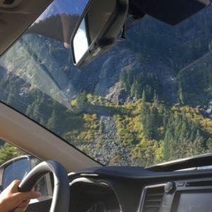 Highlander driving through the mountains