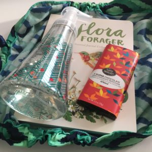 Using Lilywraps reusable gift wrap to wrap holiday shopping finds