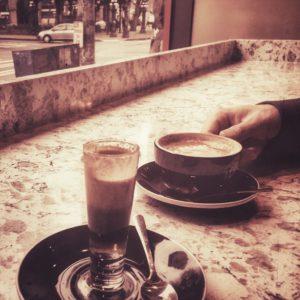 Coffee in the window at Caffe Da'rete Pioneer Square