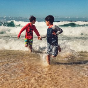 Splashing in the waves at Bondi Beach in Australia with kids