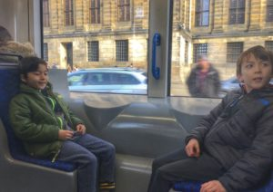 Riding a tram with kids in Amsterdam
