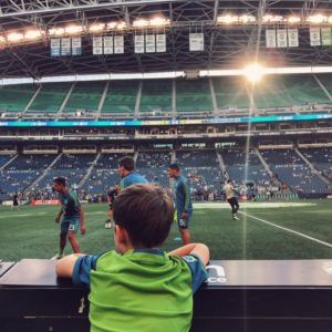 Pitchside with kids in Seattle at a Sounders Game